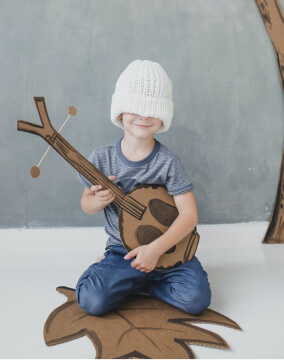 boy with paper guitar